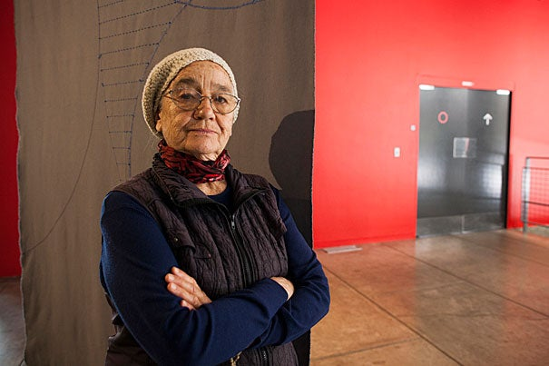 """Choreographer Carmen Beuchat is pictured during the dress rehearsal for """"Embodied Absence,"""" which looks at Chilean art following the Pinochet coup. Art was often couched in coded language to evade censorship, and exhibited in public spaces using the human body as primary medium."""