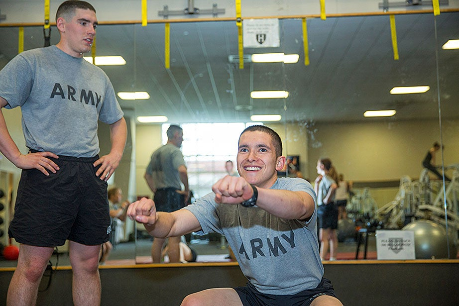 "Army ROTC cadets Luke Pumiglia '17 (from left) and Nathan Williams '18 participate in PT at the Murr Center. ""I joined Army ROTC because I was dedicated to helping and serving other people — my ultimate goal is to serve as an Army surgeon — and the privilege to serve alongside the friends I have made in Army ROTC,"" said Pumiglia."