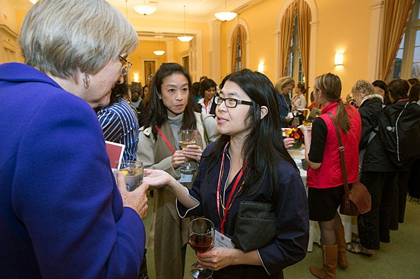 President Faust speaks with Rebecca Woo '89 (center), and Theresa Loong '94 before making welcoming remarks at the inaugural Harvard Alumni Association's Women's Weekend. Jon Chase/Harvard Staff Photographer