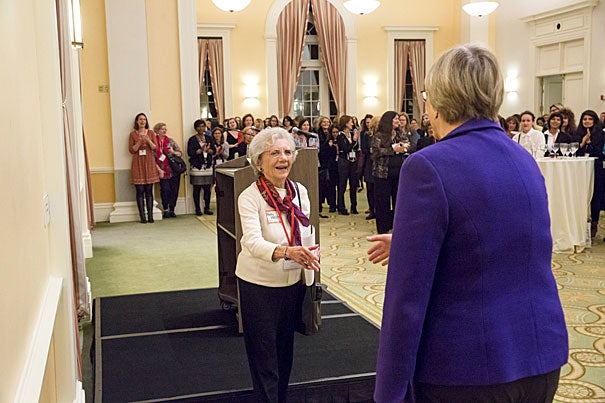 Acey Welch, Radcliffe '53, greets President Faust after introducing her to the gathering. Jon Chase/Harvard Staff Photographer