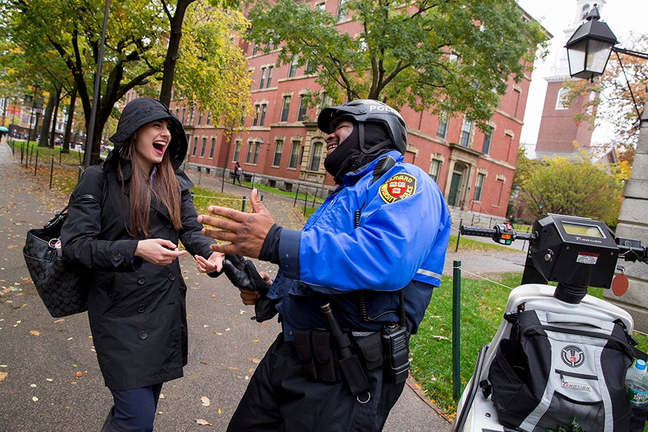 In Harvard Yard Lender shares a laugh with Josiah Christian of the Harvard University Police Department.