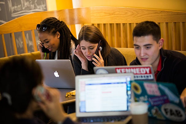 On Election Day, the Harvard College Democrats participate in a get-out-the-vote effort in Boylston Hall at Harvard University. Gussie Roc '17 (from left), Juliana Sass '17, and Phillip Ramirez '18 make calls on behalf of the Democratic Party. Stephanie Mitchell/Harvard Staff Photographer