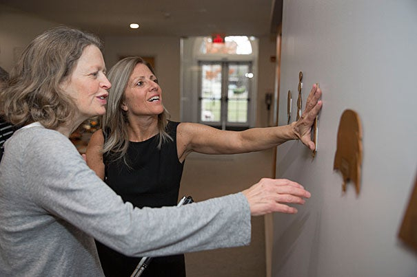 Artist Wendy Jacob (grey shirt) has created an installation with the blind and hearing impaired in mind. She tours the exhibit with writer, Nina Livingstone, (black dress) who is blind and hearing impaired. The exhibit features vibrating walls and architectural models from schools for the blind and is housed at the Johnson-Kulukundis Family Gallery in Byerly Hall. Kris Snibbe/Harvard Staff Photographer