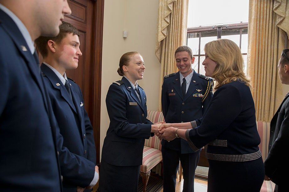 Deborah Lee James (right), the 23rd Secretary of the Air Force, shakes hands with Kira Headrick '17 (left). Harvard President Drew Faust welcomed the return of the Air Force Reserve Officer Training Corps program to campus with a ceremonial signing and reception inside Loeb House on April 22, 2016. Also present are Ryan Comrie '19 (from far left), Peter Hartnett '19, and Alexander Farrow '16. Rose Lincoln /Harvard Staff Photographer