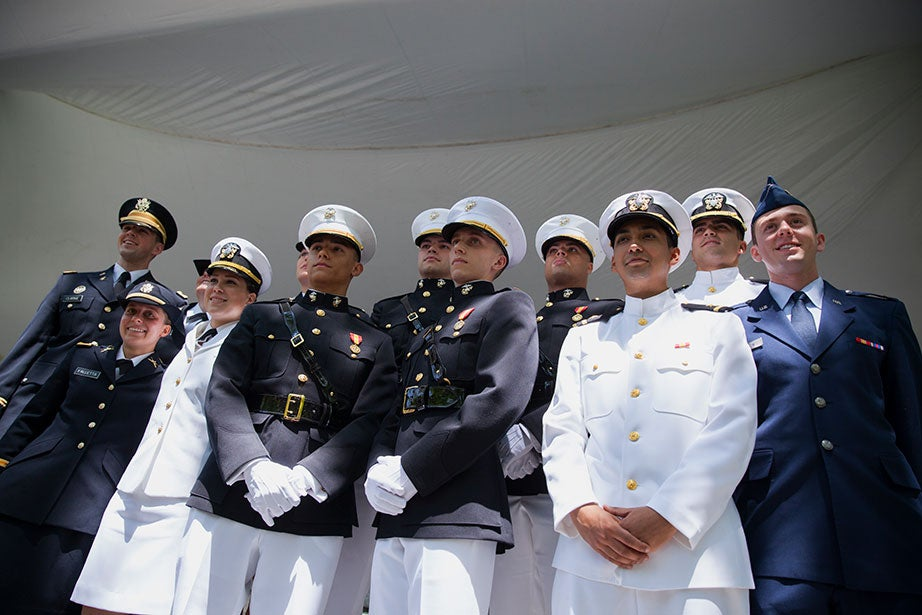 During the ROTC Commissioning Ceremony for the Class of 2016 in Tercentenary Theatre, 12 graduates proudly stood together: James Clarke (from left at rear), Lucy Perkins (blocked), Carolyn Pushaw (blocked), Robert Solmssen, Myles Stroud, and Adam Gracia; Charley Falletta (from left to right, front), Anne Nonnamaker, Francis Davis, Steven Wessman, Jimmy Castaño, and Alexander Farrow. Stephanie Mitchell/Harvard Staff Photographer