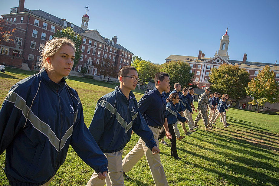 As part of Harvard's first-ever Air Force ROTC academic classes and Leadership Laboratory at the Radcliffe Quadrangle, Rachel Collins '20 (far left) practices marching with ROTC students from MIT, Wellesley, and Tufts.