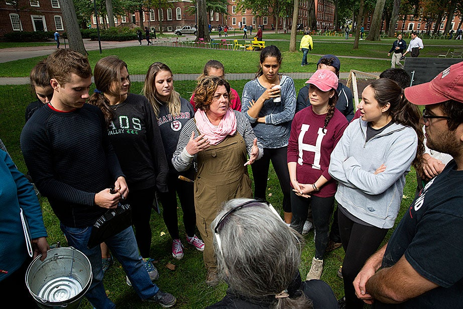 Instructor Diana Loren, center, lays out the plan for the afternoon's excavation.