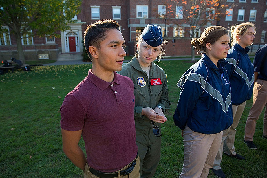 "Kira Headrick '17 (center) teaches Raul Cuevas '20 (from left) during the Air Force ROTC training as Katherine Krolicki '20 and Rachel Collins '20 stand at attention. ""As a first-year College student, I'm not entirely sure about what I want to pursue in the future,"" said Cuevas. ""However, I am certain of the inspiration I feel whenever I'm in the presence of my fellow cadets."""
