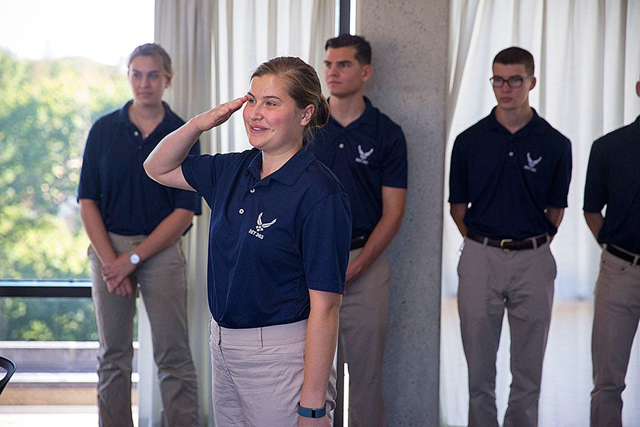 "Katherine Krolicki '20, salutes while standing at attention, while Rachel Collins '20 (left) looks on. ""My goal is to become an intelligence officer because I have a desire to serve my country,"" said Krolicki, ""Air Force ROTC has provided me with an amazing community and team. All of the cadets give me so much support in and outside of the program."""