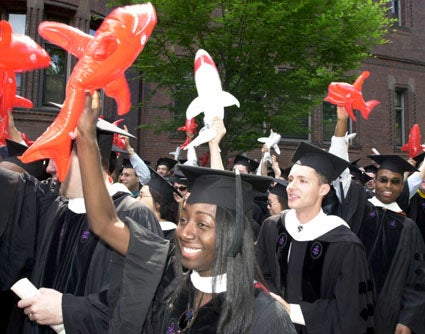 Harvard Law School graduates with inflatable sharks