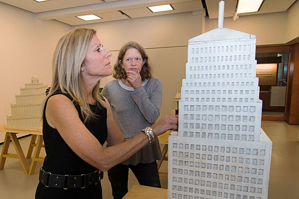 """""""The WPA models were built to be touched. It would be too bad to take them out of circulation as touchable objects, and reduce them to historical artifacts,"""" said artist Wendy Jacob as she watch NIna Livingstone """"see"""" the skyscraper through touch. Kevin Grady/Radcliffe Institute"""