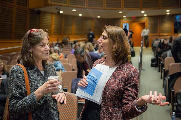 """Laura Kubzansky, (right) Lee Kum Kee Professor of Social and Behavioral Sciences talks with panelist, Lisa Berkman, during the Symposium on The Science of Health and Happiness."""" Their discussion explored the current state of science for understanding the relationship between positive mental and physical health and translation of research to influence practice and policy at the Martin Conference Center in the HMS New Research Building. Kris Snibbe/Harvard Staff Photographer"""