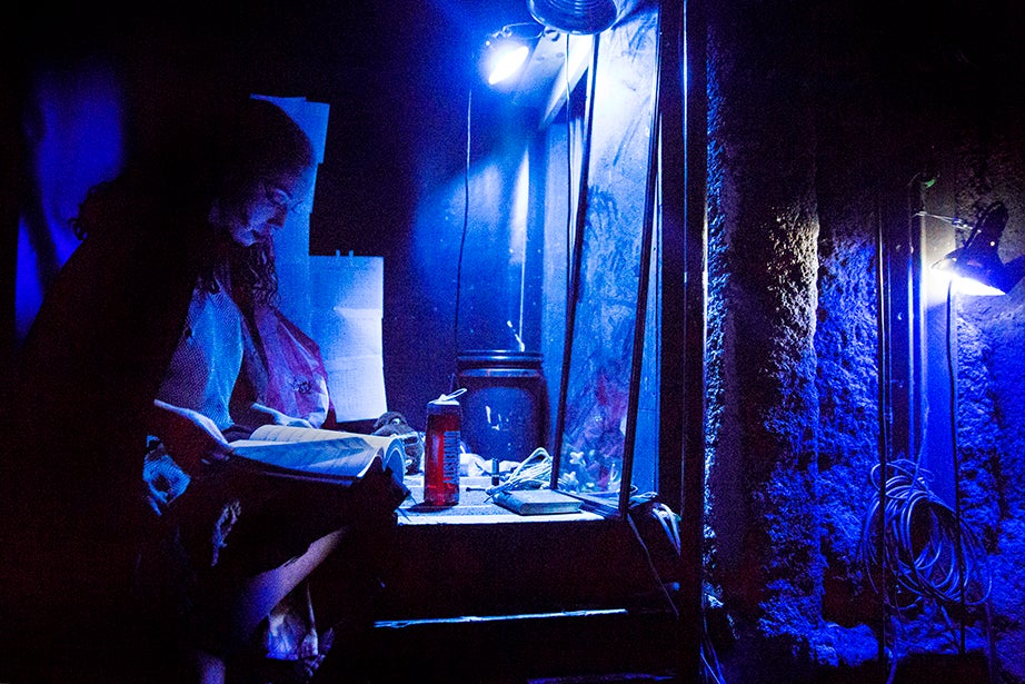 With finals just around the corner, Ashley LaLonde sneaks in time between scenes to study backstage.