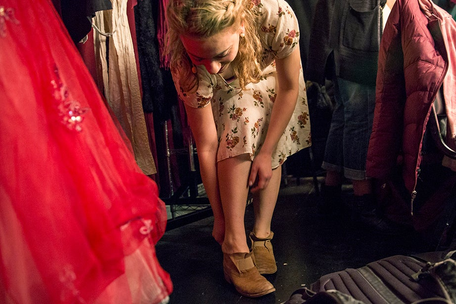 Before they transform into her iconic golden slippers, Arianna Paz, who plays Cinderella, slips on brown boots for the top of the show.