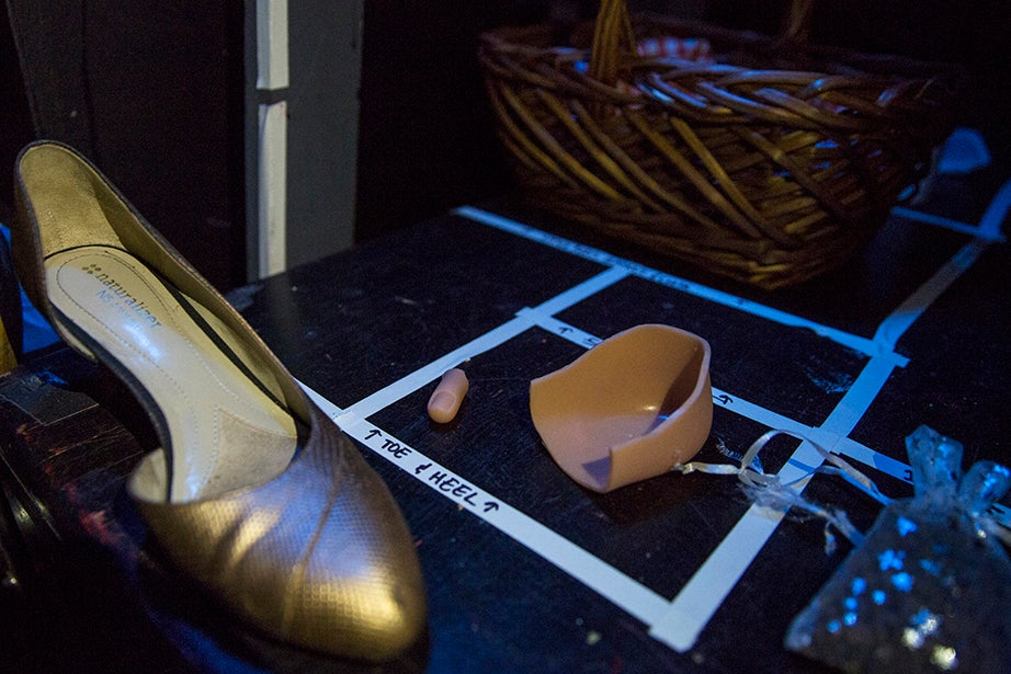 """Props such as a rubber toe and heel are meticulously arranged on a table backstage. Cinderella's stepmother cuts off part of her daughters' feet during """"Careful My Toe,"""" so that one may fit into Cinderella's golden shoe."""