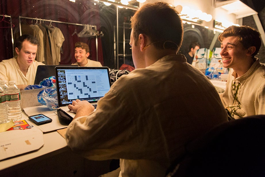 As their female cast mates meticulously apply makeup, Derek Speedy and Eli Troen, who play the Baker and Jack, respectively, solve a crossword puzzle in the men's dressing room.