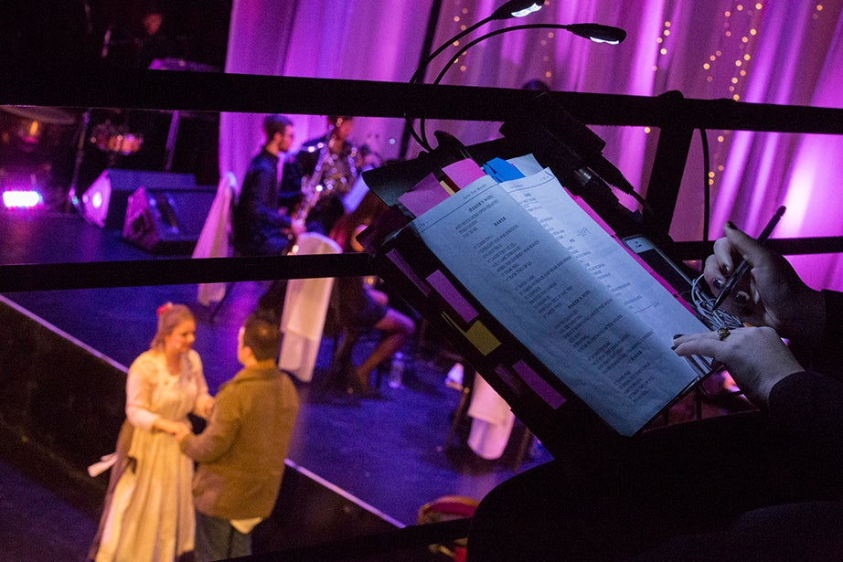 """Sarah Grammer takes notes on her master script as she watches the Baker, Derek Speedy, and the Baker's Wife, Eliza Mantz, perform """"It Takes Two."""""""