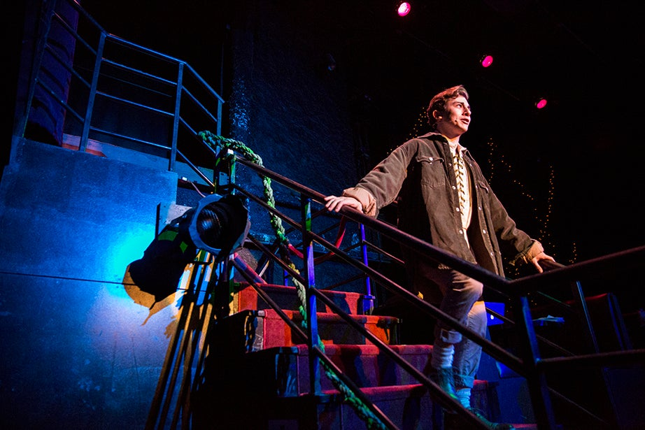 """Jack, played by Eli Troen, delivers a passionate performance of """"Giants in the Sky,"""" in which he scales and leaps from booths and runs through the theater to signify his journey up the beanstalk."""