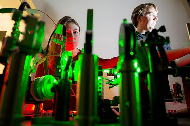 """PH.D. candidates Jenny Schloss (left) and Matthew Turner are co-authors of a recent paper on using nitrogen vacancy centers — atomic-scale impurities in diamond — to track neural activity. """"We want to understand the brain from the single-neuron level all the way up, so we envision that this could become a tool useful both in biophysics labs and in medical studies,"""" said Schloss."""