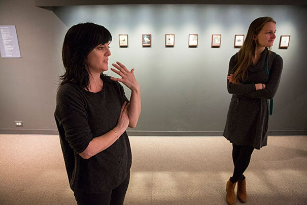 "Visual artist Christina Seely, explains her Harvard Museum of Natural History exhibition on extinction, as seen through an artist's lens, called ""Next of Kin"". during a staff preview on Friday. On the right is Clara Chaisson, a Boston-based writer and Earthwire's associate editor. Kris Snibbe/Harvard Staff Photographer"
