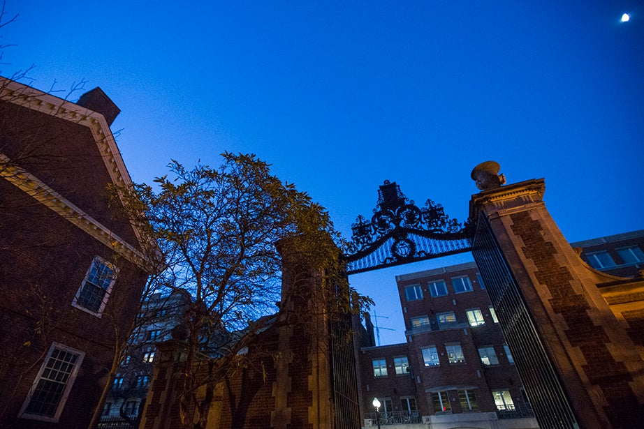 6:09 a.m. — A gate to Harvard Yard appears nearly in silhouette moments before the sun rises.