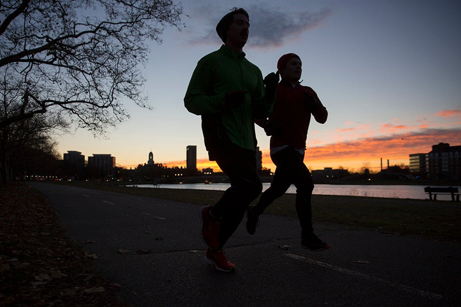 6:34 a.m. — A pair of runners, clad in winter hats and gloves, brave the harsh 30-degree temperatures for a predawn run along the Esplanade.