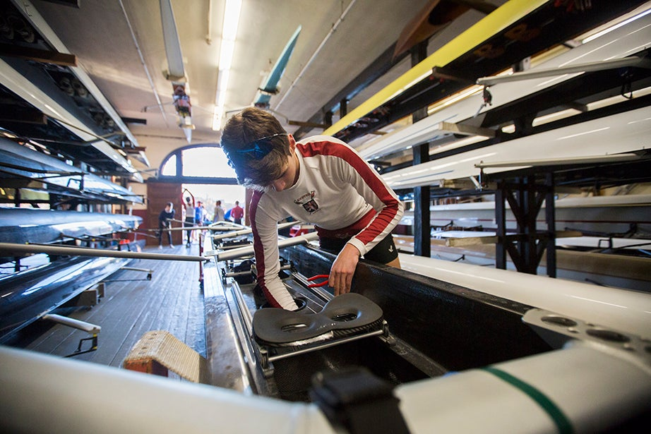 7:22 a.m. — Harvard University freshman Oliver Hansen, a member of the men's lightweight crew team, makes adjustments to a boat inside the Newell Boathouse before practice.