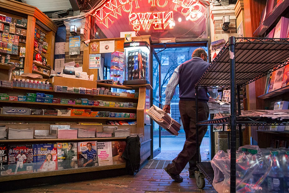 6:49 a.m. — Mohamed Rahman unloads newspapers from around the world at Out of Town News, as he does each morning beginning around 6:30 a.m.