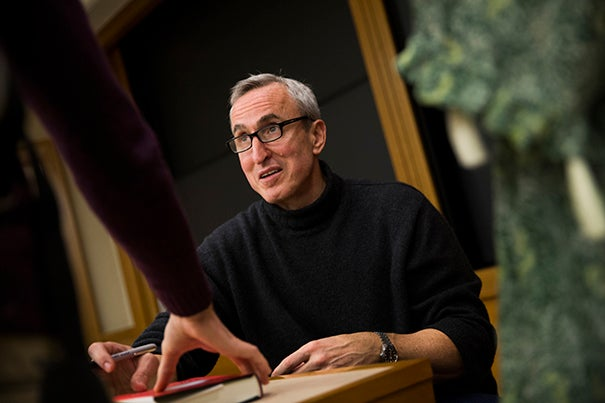 """Gary Taubes signs copies of his book """"The Case Against Sugar"""" following his talk for the Food Law and Policy Clinic. The acclaimed science writer hypothesizes that sugar """"has deleterious effects on the human body that lead to obesity and diabetes, and that it should be considered a prime suspect [in the national dietary epidemic]."""""""
