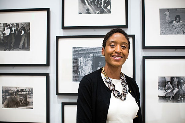 Makeda Best, former PhD student of Dean Robin Kelsey, is named Curator of Photography of Harvard Art Museum. She is pictured in front of photography on display in the gallery space at HAM. Stephanie Mitchell/Harvard Staff Photographer