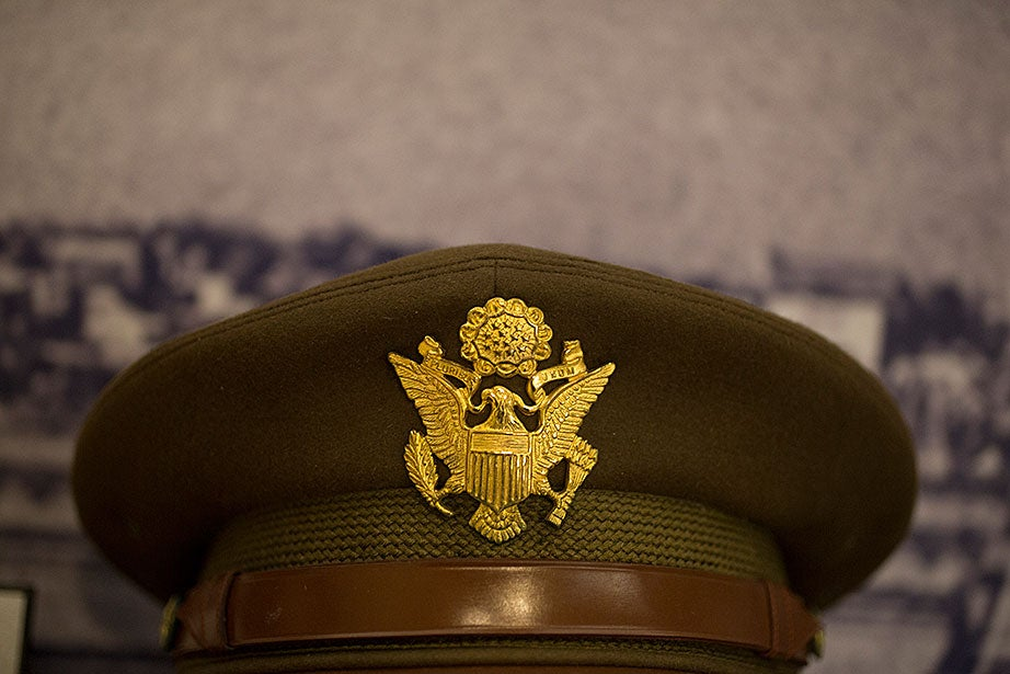 """A U.S. Army dress cap from the collection of Lieutenant Colonel Norman T. Newton, a Harvard landscape architecture professor. Newton spent three years traveling through Italy as part of the Monuments, Fine Arts, and Archives program (""""The Monuments Men"""") that worked to survey, protect, and recover cultural artifacts in areas affected by World War II."""