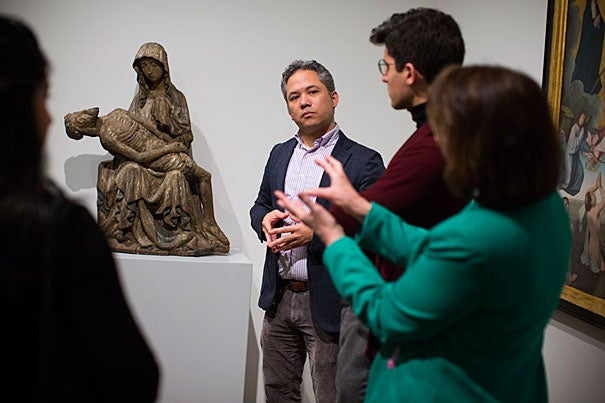 Arts, Creativity and Medicine is a Wintersession class led by Harvard Medical School faculty, residents and medical students who are also practicing artists and musicians. The workshops and discussions take place in the Harvard Art Museums. David Odo (from center) and Elizabeth Rider (right) take students through the collections to discuss the connections between art and medicine.