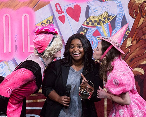 Hasty Pudding Woman of the Year Octavia Spencer brandishes her pudding pot as she is flanked by members of Hasty Pudding Theatricals in Farkas Hall.