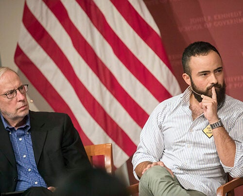 "Dan Balz (left) and Carlos Rojas listen during ""DACA: What's next"" at the JFK Jr. Forum. ""[U]ndocumented youth are no longer willing to throw our parents, future immigrants, and people who live on the border under the bus,"" said Rojas."