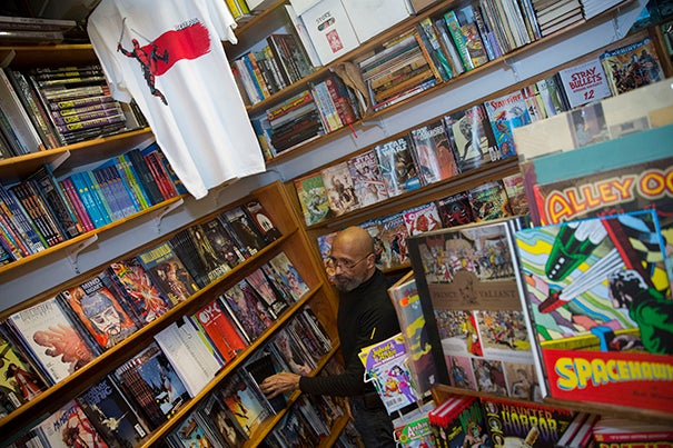 "As part of a student column about ""The Hidden Spots of Harvard Square: A Student's Guide"" the Million Year Picnic comic book store was featured. Employee, Michael Phillips stocks the shelves inside the store. Kris Snibbe/Harvard Staff Photographer"