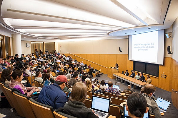 Students and researchers listen to a discussion on the challenges of working with big data at the Data Concepts Panel during Harvard DataFest.