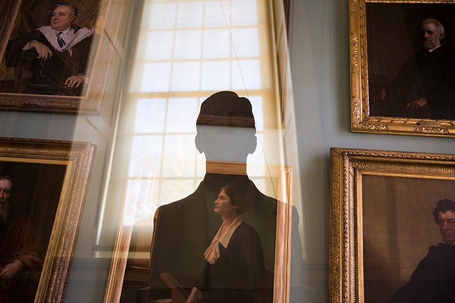 Portraits and sculptures of historic Harvard leaders mingle in the Faculty Room of University Hall. LeBaron Russell Briggs, who served as dean of Harvard College and president of Radcliffe, is eclipsed in the light of the window, while Cecilia Payne-Gaposchkin, Phillips Professor of Astronomy, is caught in a contemplative gaze at the night sky.