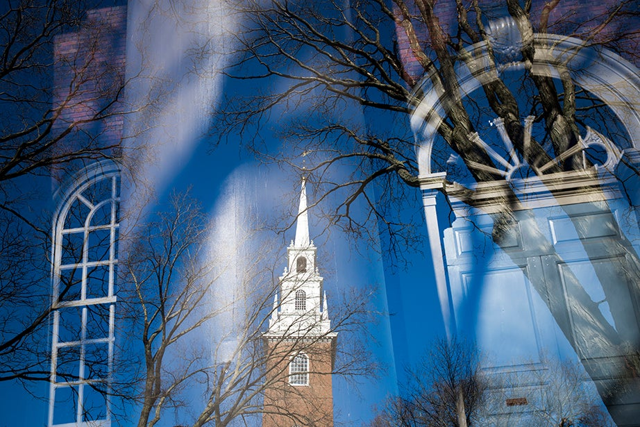 The tower of Memorial Church adorns its own entrance. The church, built in 1932, was dedicated on Armistice Day to honor the men and women of Harvard who died in WWI.