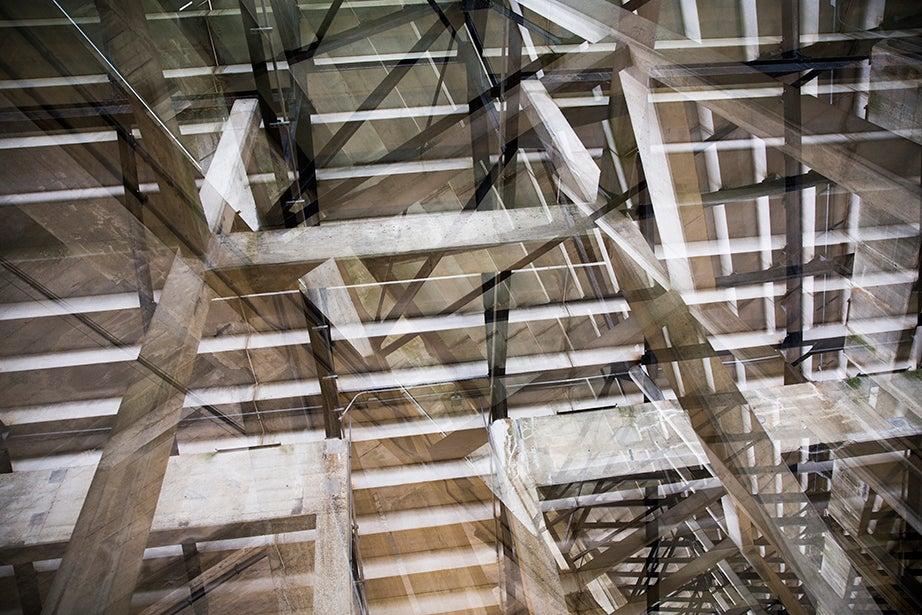 The underbelly of Harvard Stadium forms a kaleidoscope, an abstraction of steps and stairs.
