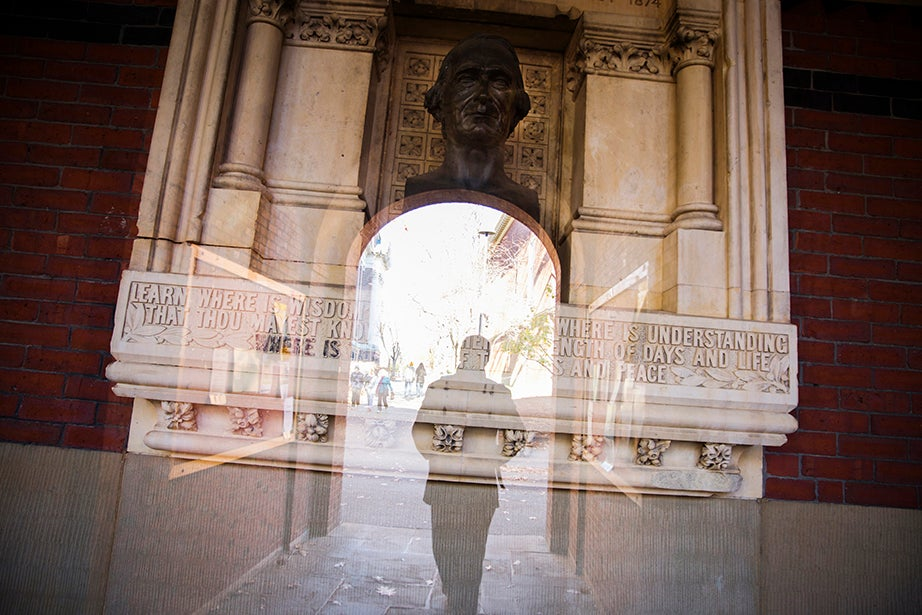 """Scholars enter gateways to the Yard in the spirit of the inscription under the bust of James Walker, past president and overseers of Harvard College: """"Learn where is wisdom, where is strength, where is understanding; that thou mayest know also where is length of days, and life, where is the light of the eyes and peace."""""""