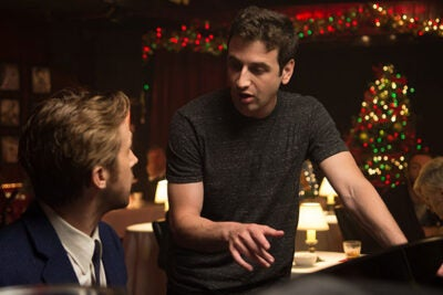 "Composer Justin Hurwitz speaks with actor Ryan Gosling on the set of ""La La Land."" Hurwitz credits his Harvard education with opening up ""a lot of possibilities to me as a composer."""