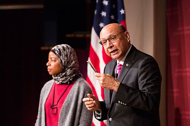 Khizir Khan, LL.M. '86, holds the pocket Constitution that he famously offered to lend to Donald Trump during the 2016 Democratic National Convention. Khan joined Intisar A. Rabb (left), law professor and director of the Islamic Legal Studies Program at Harvard Law School, to discuss civil liberties and political action.