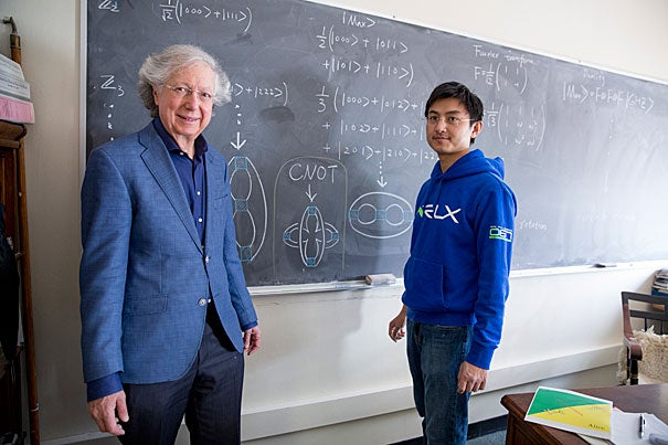 """""""[A] picture is worth 1,000 symbols,"""" quips Professor Arthur Jaffe (left). Jaffe and  postdoctoral fellow Zhengwei Liu have developed a pictorial mathematical language that can convey pages of algebraic equations in a single 3-D drawing."""