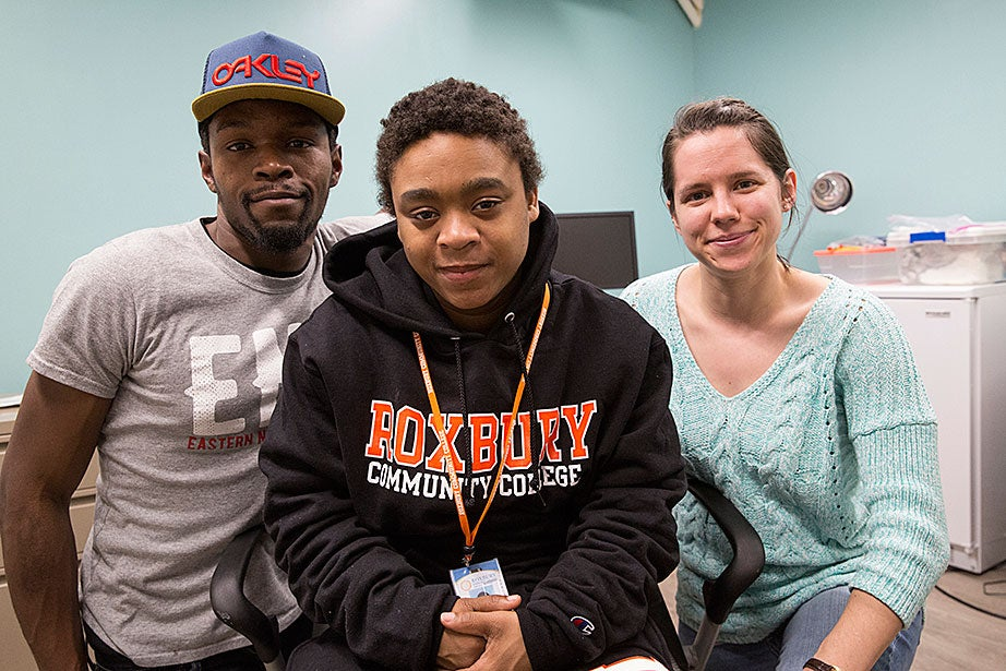 Guests Dorell B. (from left) and Janet B. pose with fifth-year Graduate School of Arts and Sciences student Sam Wellington. Dorell is hoping to enroll at Bunker Hill Community College. Janet is studying to be a veterinarian at Roxbury Community College. Both appreciate the help Y2Y gives them with housing and job issues, as well as the stress-free environment there. Sam studies tuberculosis and will be getting her Ph.D. in chemical biology this spring. She volunteers for nearly 30 hours a week, and appreciates the people focus at Y2Y, so different from her lab work.