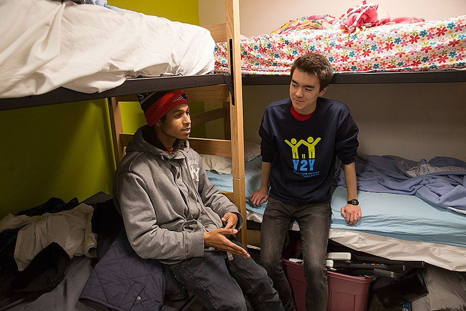 Michael speaks with student director Nathan Cummings '18 in the privacy of a bunk room for staffers who work the overnight shift. Harvard student directors such as Nathan, as well as Law School students and youth workers from outside agencies, are available nightly to help guests with housing, health, employment, and personal issues.