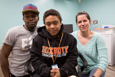 Y2Y homeless shelter guests Dorell B. (from left) and Janet B. pose with 5th year GSAS student Sam Wellington. Y2Y is a student-run homeless shelter, founded and staffed by Harvard students, that caters exclusively to young adults.