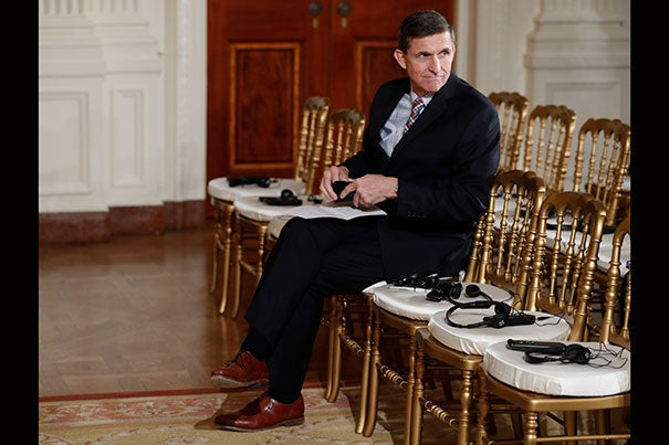 National Security Adviser Michael Flynn sits in the front row before the start of the President Donald Trump and Japanese Prime Minister Shinzo Abe joint new conference in the East Room of the White House, in Washington, Friday, Feb. 10, 2017. (AP Photo/Carolyn Kaster)