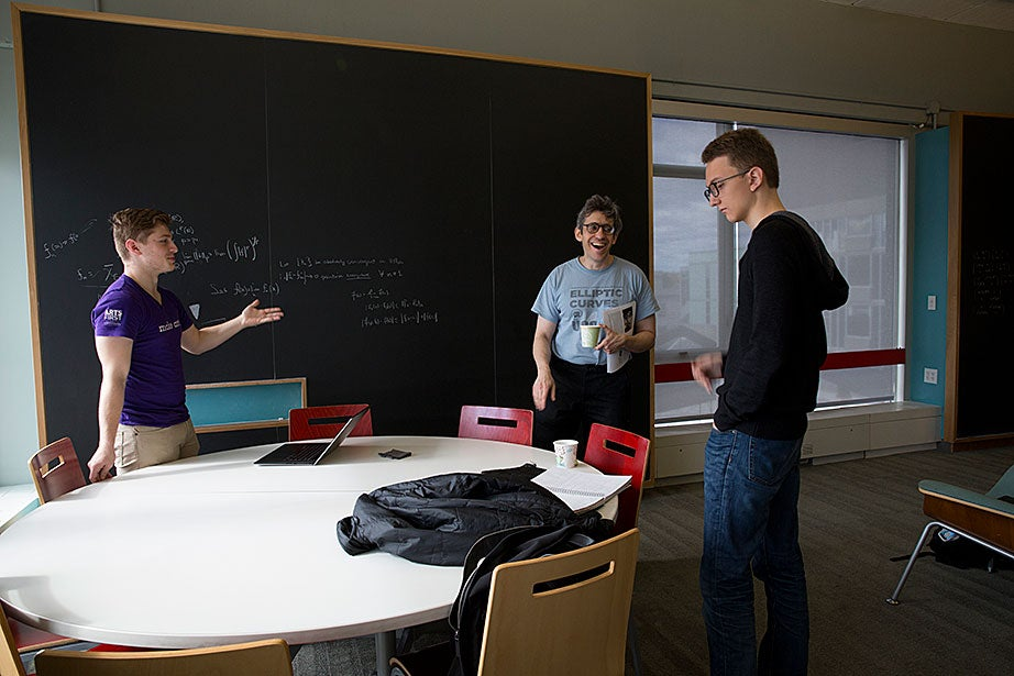 Reuben Stern '20 (left), Professor Noam Elkies, and James Hotchkiss '18 discuss beats in classical music in the fourth floor math lounge at the Science Center.
