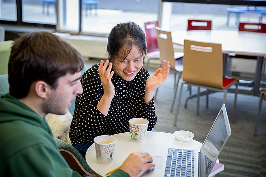 Gray Putnam '17 (left) and graduate student Lily Yichen Shi work on a physics lab report.