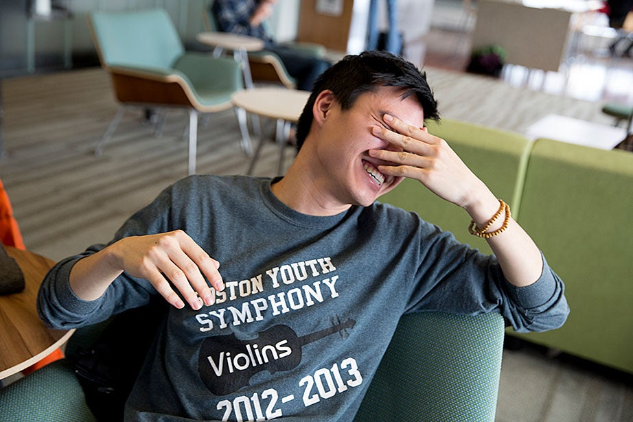 Kevin Yang '17 shares a laugh of frustration while trying to solve a problem.